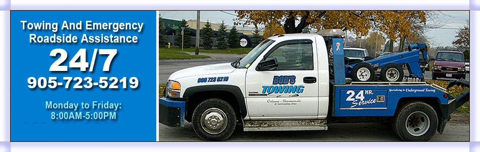 side view of Bob's Towing tow trucks
